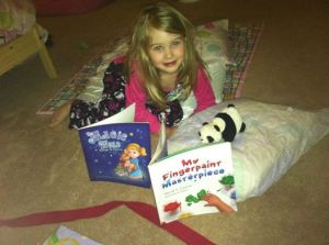 Abby LOVES my books!